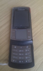 Rebecca's battered phone.
